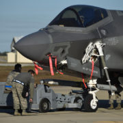 A U.S. Air Force weapons load crew loads a live AIM-120 advanced medium-range air-to-air missile into an F-35A January 31, 2017, at Eglin Air Force Base, Florida.