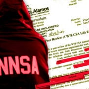 An NNSA employee in front of documents obtained by POGO