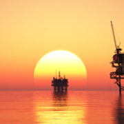 Offshore oil rigs at sunset