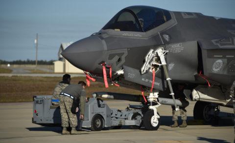 A U.S. Air Force weapons load crew loads a live AIM-120 advanced medium-range air-to-air missile into an F-35A January 31, 2017, at Eglin Air Force Base, Florida.