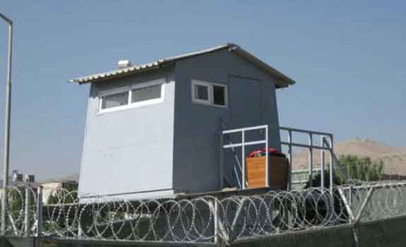 Photo of Camp Falcon guard tower via the State Department Office of Inspector General.