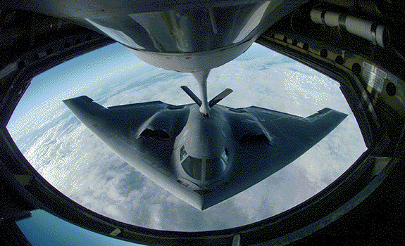 Photograph of a B-2 during aerial refueling over the Pacific Ocean
