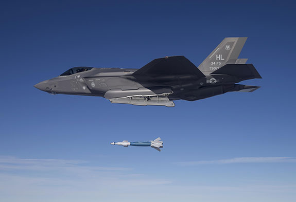 Photograph of an F-35 Lightning II drops a GBU-12 laser-guided bomb