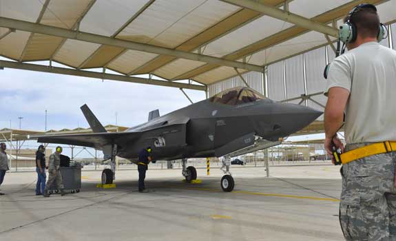 Photograph of an F-35 being marshalled in after a training exercise.