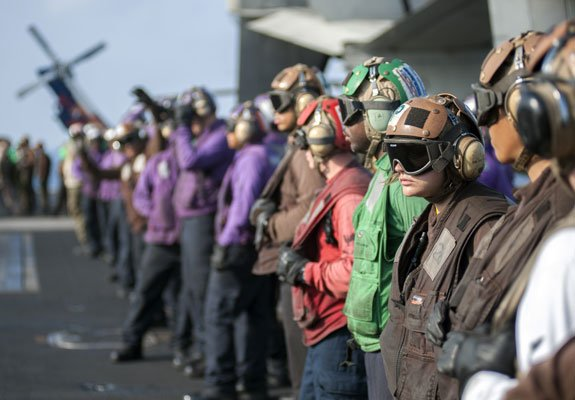 Photograph of Navy Troops on deck of Aircraft Carrier