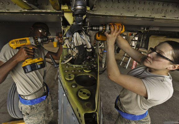 Photographs of soldier mechanics working on aircraft