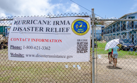 A sign informs residents how to register for FEMA assistance after the island was devastated by Hurricane Irma.