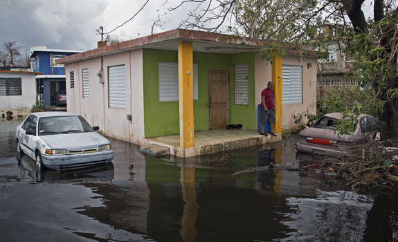 People in the community of Miñi Miñi wait for the water to reced. The municipality of Loíza, as well as the rest of Puerto Rico was severely affected by category 4 Hurricane Maria.