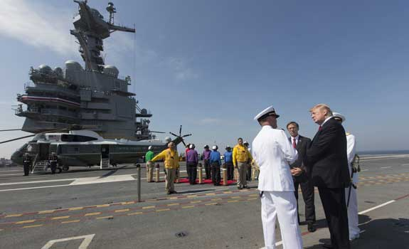 Photo of the  Commissioning Ceremony of the USS Gerald R. Ford with President Trump beside the ship