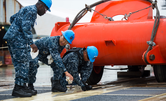 Sailors from the USS Gerald R. Ford (CVN 78) prepare to test the ship's Electromagnetic Aircraft Launch System.
