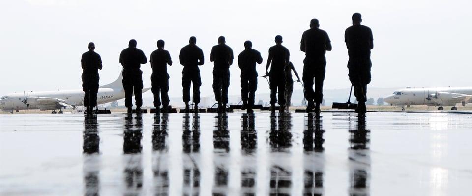 US Navy Sailors cleaning a hangar