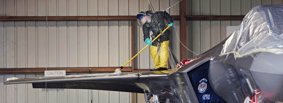 An Airman cleans the top of an F-35A Lightning II.