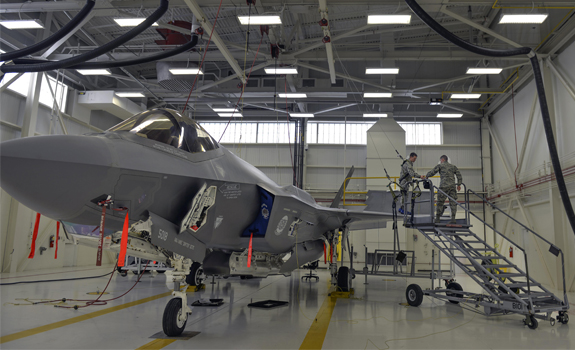 Airmen don safety gear to prepare an F-35A Lightning II for maintenance.