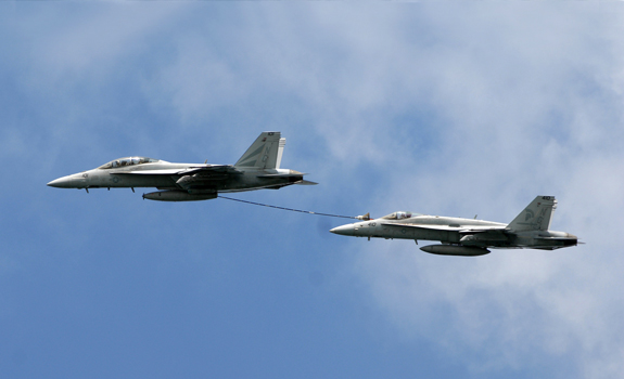 An F/A-18F Super Hornet and an F/A-18C Hornet from Naval Air Station North Island demonstrate their mid-air refueling capabilities during San Diego's Sea and Air Parade