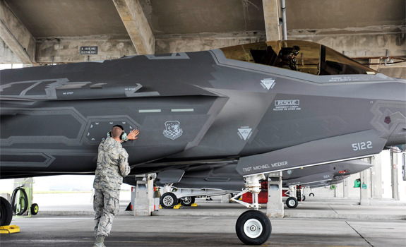 An airman inspects an F-35A Lightning II before takeoff.