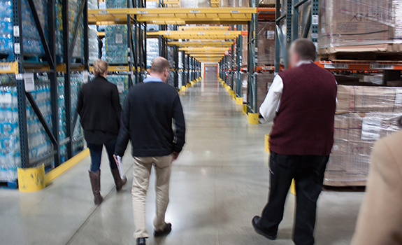 POGO staff tour a FEMA commodity distribution center.
